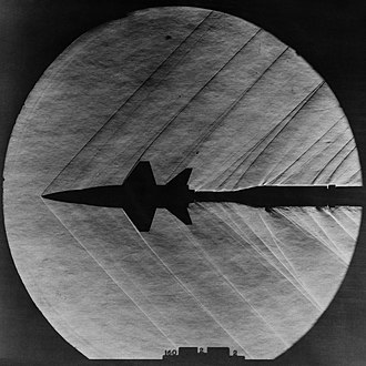 Compressible flow - Attached shock wave shown on a X-15 Model in a supersonic wind tunnel