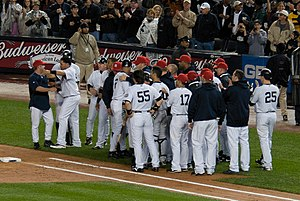 2009 New York Yankees season - Yankees celebrate Derek Jeter after Jeter breaks record for hits in Yankee history.