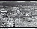 131776 LOOKING EAST OF THE CITY, SHOWING THE REBUILDING AND CLEARING THAT HAS BEEN CARRIED OUT ONE YEAR AFTER THE ATOM BOMB WAS DROPPED.JPG