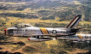 Osan Air Base - North American F-86F-25-NH Sabre AF Serial No. 52-5371 of the 18th Fighter-Bomber Group, 1953. Aircraft marked as Wing Commander's.