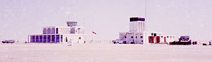 Dubai International Airport - Dubai Airport fire station and terminal/control tower seen from the landside, early 1965.