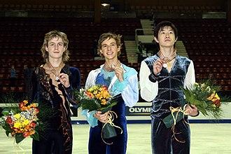 2008 World Junior Figure Skating Championships - The men's podium. From left: Artem Borodulin (2nd), Adam Rippon (1st), Guan Jinlin (3rd).
