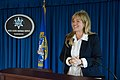 2015 Law Enforcement Explorers Conference woman grinning at podium.jpg