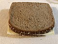 2019-02-06 21 07 49 A couple slices of Kraft Singles White American cheese in between two slices of Arnold Whole Grain 100% Wheat Bread in Dunn Loring, Fairfax County, Virginia.jpg