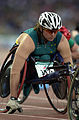 231000 - Athletics wheelchair racing 800m T54 final Louise Sauvage concentrates - 3b - 2000 Sydney race photo.jpg