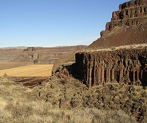 Moses Coulee - Three Devil's grade in Moses Coulee, Washington. The upper basalt is Roza Member, while the lower canyon exposes Frenchmen Springs Member basalt.