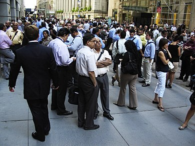 A crowd of evacuated businesspeople on Wall Street in New York City. Image: Alec Tabak.