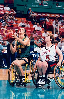 Women competing in wheelchair basketball