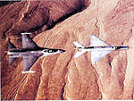 4477th Test and Evaluation Squadron MiG-21 F-13 with Nellis F-16.jpg