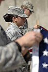 A1C Ana Pacheco, with the 438th Air Expeditionary Advisory Squadron, folds an American flag during 9-11 events at Kabul IAP.jpg