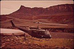 A Helicopter Brings a Fresh Work Shift to the Site of Clean - Up Operations Following a Massive Oil Spill Into the San Juan River Crews Worked Round the Clock at This Log Boom in Monument Valley Utah, 10-1972 (3814160249).jpg