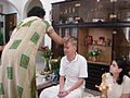 A Tilaka being applied on forehead, Hindu wedding ritual.jpg