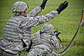 A U.S. Soldier assigned to Alpha Company, 1st Battalion, 114th Infantry Regiment, 50th Infantry Brigade Combat Team, New Jersey Army National Guard tosses an ammunition belt to a fellow heavy weapons crew member 130814-Z-NI803-317.jpg