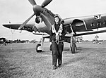 A Women's Royal Naval Service radio mechanic walks from a Fairey Barracuda torpedo bomber at RNAS Lee-on-Solent, September 1943. A19294.jpg
