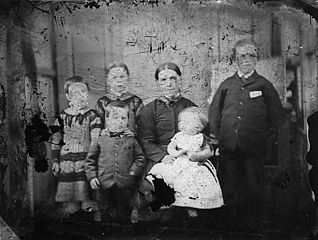 A group including a woman and five children