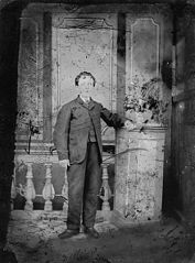 A young man standing