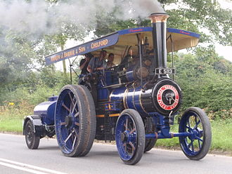 Traction engine - Preserved Burrell road locomotive pulling a water cart, near Jodrell Bank, Cheshire, England