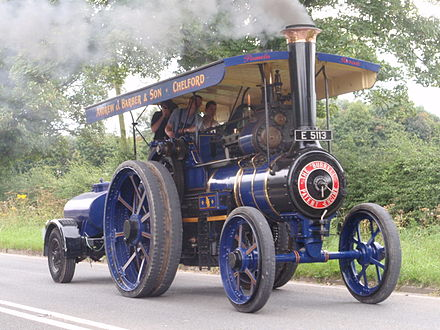 Preserved Burrell road locomotive pulling a water cart, near Jodrell Bank, Cheshire, England