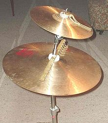 "Chain sizzlers mounted on a Paiste 11"" trad splash (top) and Paiste 2002 18"" medium"