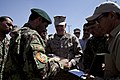 Afghan National Army (ANA) Maj. Gen. Sayed Malook, left, the commanding general of the 215th Corps, presents a plaque to U.S. Marine Corps Gen. Joseph F. Dunford, the commanding general of the International 130527-M-RF397-224.jpg