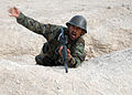 Afghan National Army Basic Warrior Trainee simulates throwing a hand grenade (5085969454).jpg