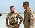 Air Commodore Ken McCann, United Kingdom Air Component Commander and Lt. Col. Olaf Holm of the 438th Air Expeditionary Advisory Group at the Afghan National Army Air Corps base in Kabul.jpg