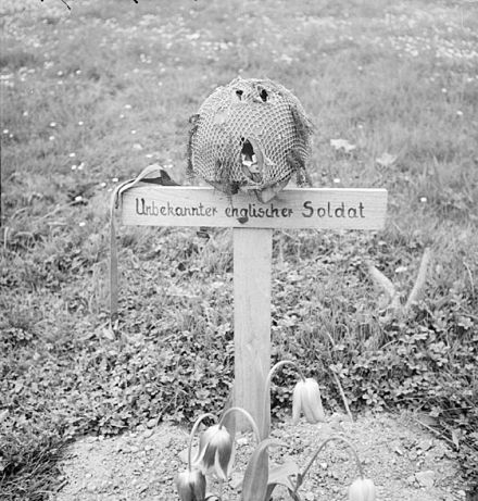 The grave of an unknown British airborne soldier at Arnhem, photographed after its liberation 15 April 1945. Airborne grave, Arnhem 1945.jpg