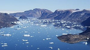 Alison Bay - Left to right: Saqqarlersuaq Island, Greenland ice sheet (behind), Saqqarlersuup Sullua (front), tiny Uummannaarsukassak Island, Alison Bay (behind), Wandel Land (farther behind), Kiatassuaq Island.
