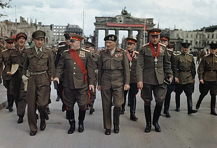 Marshals Zhukov and Rokossovsky with General Sokolovsky leave the Brandenburg Gate after being decorated by Montgomery Allies at the Brandenburg Gate, 1945.jpg