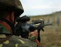 An Azerbaijan Land Forces (ALF) soldier fires an M16A4 rifle during a training exercise in the Babadag Training Area in Romania 110804-M-OB762-002.jpg