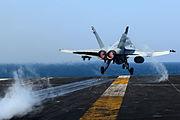 An FA-18C Hornet launches.