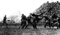 Angus Goetz attempting to block punt (1920).png