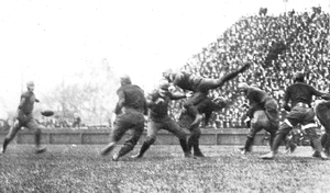 1920 Michigan Wolverines football team - Team captain Angus Goetz leaps in effort to block punt by Hellstrom of Illinois