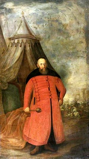Stanisław Koniecpolski - Koniecpolski with a hetman's buława, portraited in a military encampment against a battle, National Museum in Warsaw