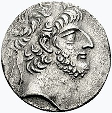 Coin with the bust of a hawk-nosed, bearded, curly-haired man wearing a diadem