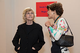 Artist Sandy Skoglund (left) in conversation with a gallery visitor.jpg