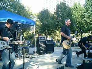Another Single Day - Guitarist Brian Holzgang, Lead Singer Nathan Cody, Bassist John Marshall, Drummer Casey Fowler (behind Holzgang) at Cesar Chavez Park in Sacramento