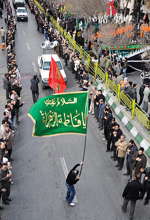 Shia view of Fatimah - Ashura day in Arak with a Fatimid green flag.