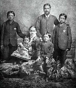 Aurobindo (seated center next to his mother) and his family. In England, ca. 1879. Aurobindo.family.jpg