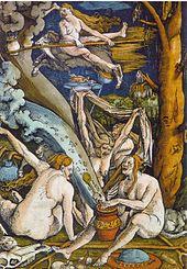 varias ancianas desnudas al pie de un árbol, con varios objetos (calderos, escobas, chivo)