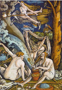 Varias mujeres desnudas entradas en años, al pie de un árbol, y con diversos objetos (calderos, escobas, machos cabríos).