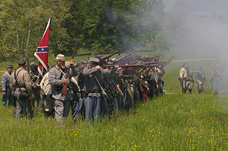 American Civil War reenactment - Confederate reenactors fire their rifles during a reenactment of the Battle of Chancellorsville in May 2008.