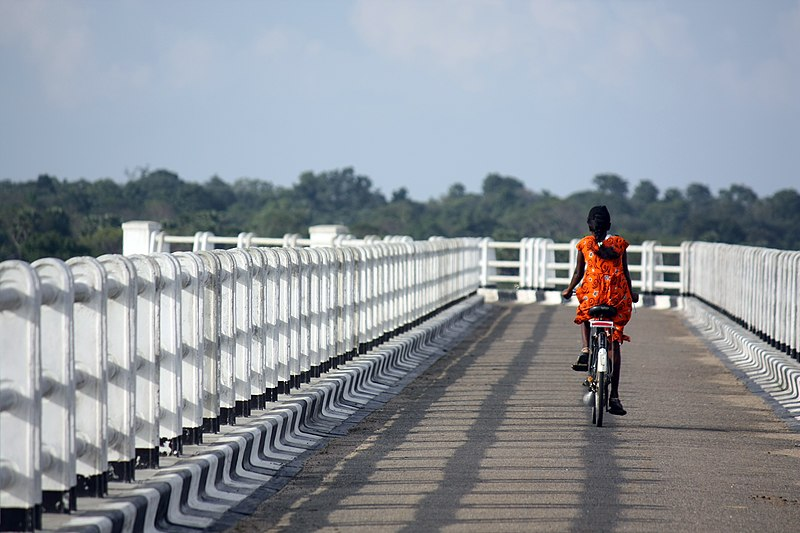 Bicycling Tamil girl, Batticaloa.JPG
