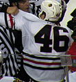 Blackhawks-Flames scrum FRASER (cropped).JPG