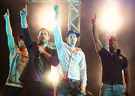 Blue performing in Manchester in 2011 (From left to right: Duncan James, Antony Costa, Lee Ryan and Simon Webbe)