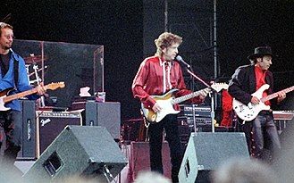 "Never Ending Tour - (From Left to right) John ""J.J."" Jackson, Dylan and Tony Garnier performing in Stockholm, Sweden, July 27, 1996"