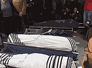 Bodies wrapped in tallit at funeral in Givat Shaul (Fogel family)
