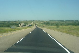 Saskatchewan Highway 16 - Borden Bridge divided highway bridges with old bridge showing arches in the background