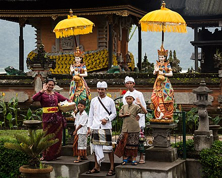 A Balinese Hindu family after puja at Bratan temple in Bali, Indonesia. Bratan Bali Indonesia Balinese-family-after-Puja-01.jpg