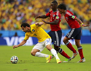 Cristián Zapata - Brazil's Fred competing Colombia's Zapata (in the middle) and Juan Cuadrado for the ball in the quarter-finals of the 2014 FIFA World Cup